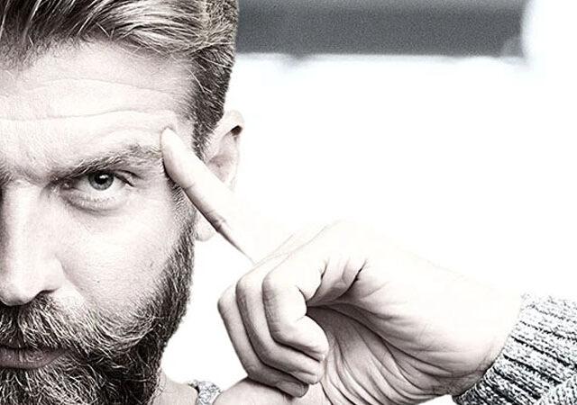 man with beard thinking